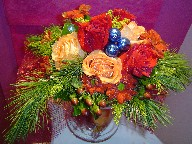 Berries, roses, daisies, solidago, and pine with Christmas decoration